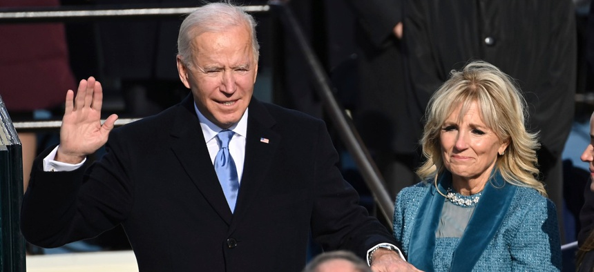 Joe Biden is sworn in as the 46th president of the United States by Chief Justice John Roberts as Jill Biden holds the bible during the 59th Presidential Inauguration on Wednesday.