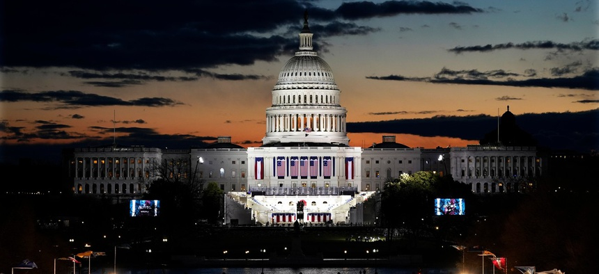 Capitol Building and stage for the swearing-in is lit as events get underway for President-elect Joe Biden's inauguration ceremony, Wednesday, Jan. 20, 2021, in Washington.