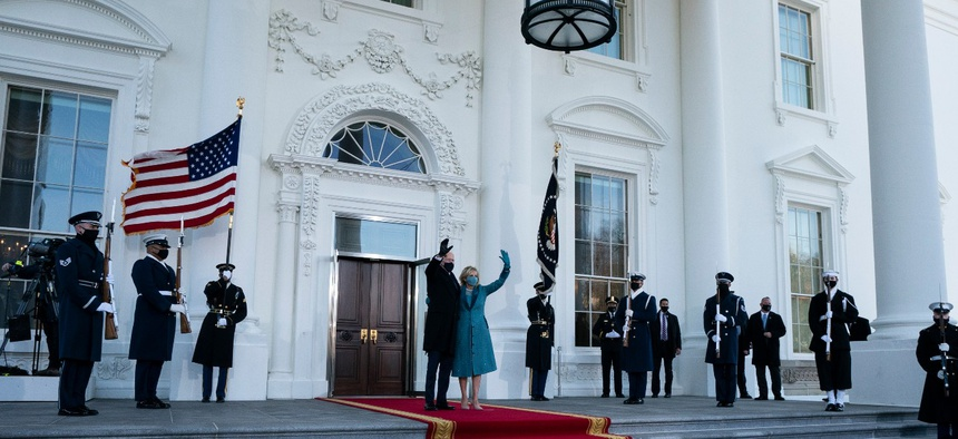 President Joe Biden and first lady Jill Biden wave as they arrive at the North Portico of the White House, Wednesday, Jan. 20, 2021, in Washington.
