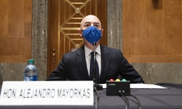 Homeland Security Secretary nominee Alejandro Mayorkas takes his seat to testify during his confirmation hearing on Tuesday.