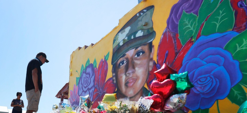 People look at a mural of slain Army Spc. Vanessa Guillen painted on a wall on the south side of Fort Worth, Texas, on July 11.