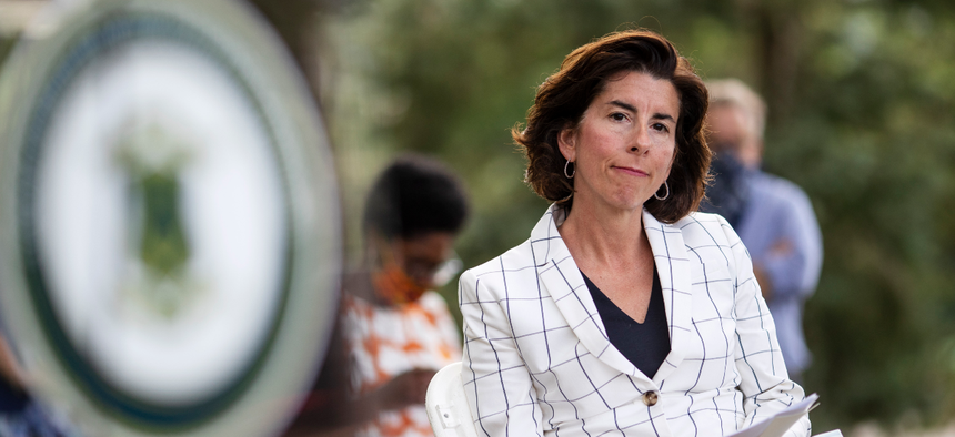 Rhode Island Gov. Gina Raimondo sits during a news conference in Providence in September.