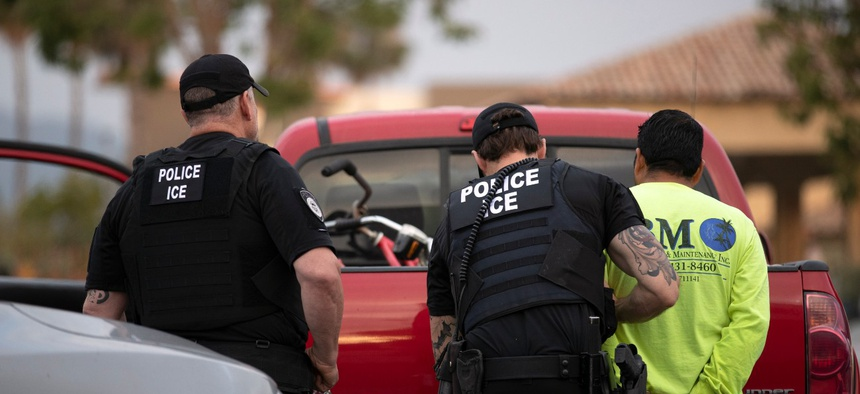 U.S. Immigration and Customs Enforcement officers detain a man during an operation in Escondido, California, in July 2019.