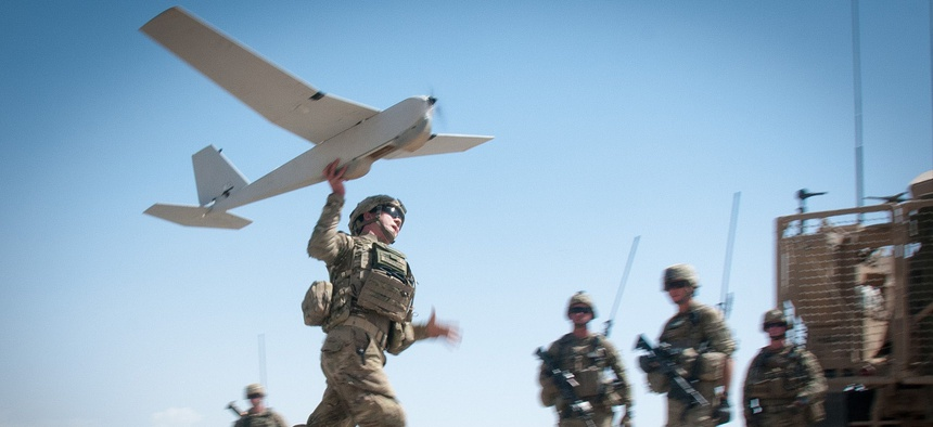 U.S. Army Chief Warrant Officer 2 Dylan Ferguson, a brigade aviation element officer with the 82nd Airborne Division's 1st Brigade Combat Team, launches a Puma unmanned aerial vehicle on June 25, 2012, in Ghazni Province, Afghanistan.