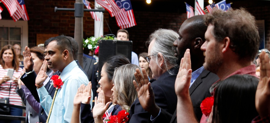 Thirteen immigrants officially become new U.S. citizens in a special naturalization ceremony on Flag Day at the historic Betsy Ross House in Philadelphia on June 14, 2019.