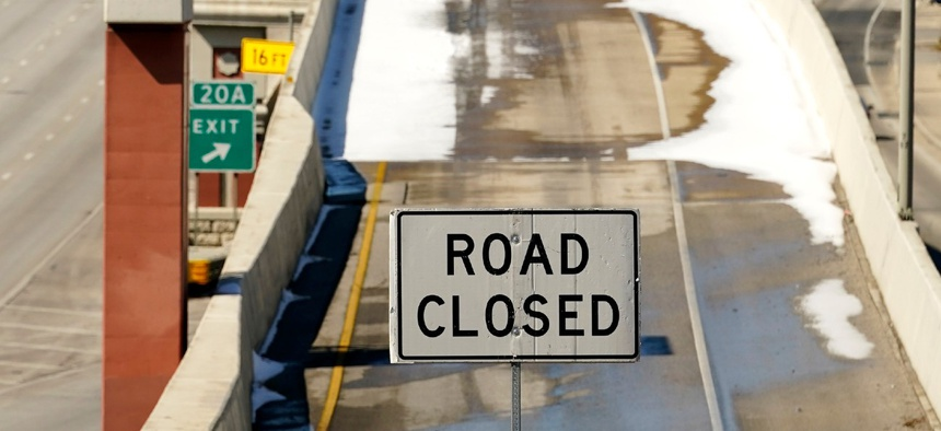 A sign blocks an on ramp to Interstate 410 on Friday in San Antonio, Texas. Many roads, highways and interstates remain closed due to icy conditions.
