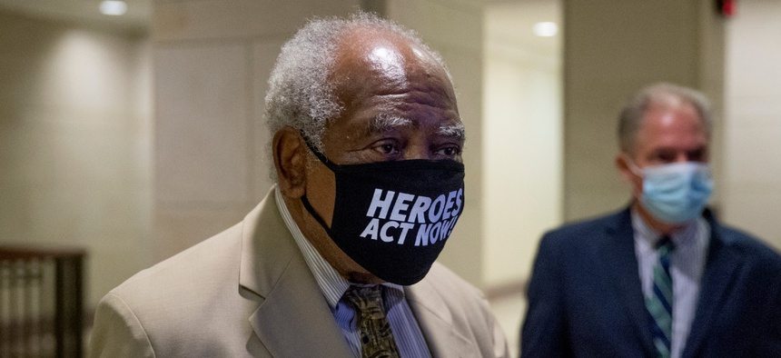 Rep. Danny Davis, D-Ill., center, arrives for a press conference on Capitol Hill over the summer. Davis is one of the lawmakers calling for changes at SSA.
