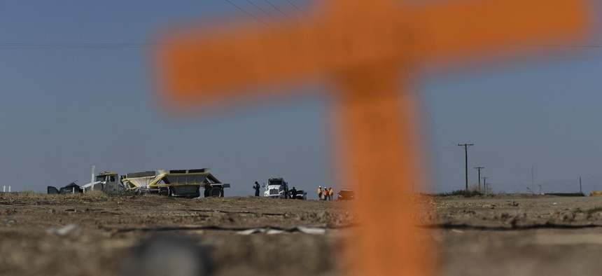 Crosses are seen near the scene of a crash between an SUV and a semi-truck full of gravel near Holtville, California on March 2, 2021