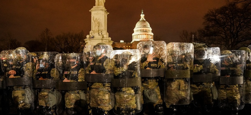 District of Columbia National Guard stand outside the Capitol on Jan. 6 after a day of rioting protesters. The poll also found an increasing number of Americans are more concerned about internal threats to the United States, such as domestic terrorism.