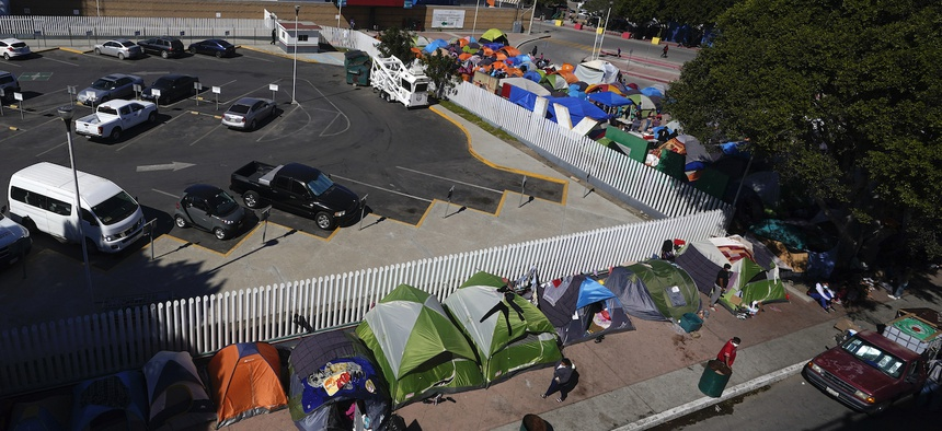 Tents used by migrants seeking asylum in the United States line an entrance to the border crossing on March 1, in Tijuana, Mexico.