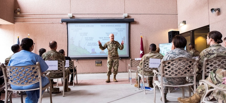 Army Lt. Gen. Ronald Place, Defense Health Agency Director, addresses members of the 99th Medical Group at Nellis Air Force Base, Nevada in February 2020.