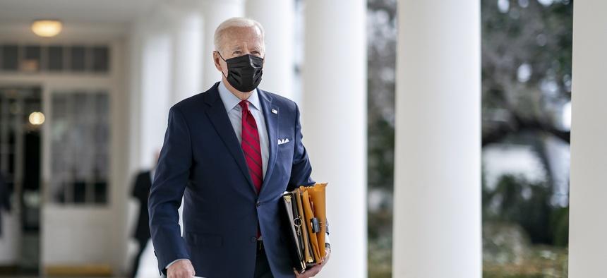 President Joe Biden walks along the Colonnade of the White House in January.