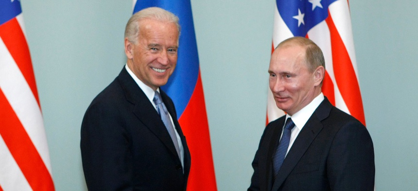 Then-Vice President Biden, left, shakes hands with Russian Prime Minister Vladimir Putin in Moscow, Russia, in March 2011.