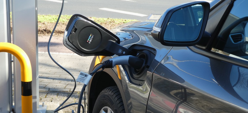 21 February 2021, North Rhine-Westphalia, Cologne: An electric car charging at an electric vehicle charging station